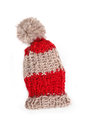 Bobble cap red and beige striped knitted warm isolated Royalty Free Stock Images