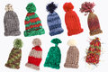 Bobble caps for winter eight knitted warm isolated Royalty Free Stock Photos