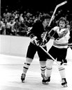 Bobby Clarke and Peter McNabb battle (NHL Hockey) Stock Photos