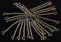 Bobby pins or hair pins scattered hairpins for holding in place on black background Stock Image