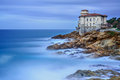 Boccale castle landmark on cliff rock and sea. Tuscany, Italy. Long exposure photography. Stock Photos