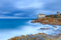 Boccale castle landmark on cliff rock and sea. Tuscany, Italy. Long exposure photography. Royalty Free Stock Image