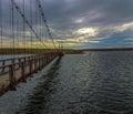 Bodie creek suspension bridge in the falkland islands malvinas near goose green taken at sunset Royalty Free Stock Image