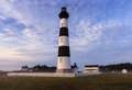 Bodie island lighthouse blue sky north carolina and keeper s quarters on the cape hatteras national seashore in on a morning in Royalty Free Stock Photography