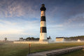 Bodie island lighthouse north carolina early in the morning as the fog still lay in the fields and the sun began to rise in Stock Images
