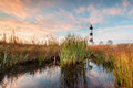 Bodie island lighthouse north carolina outer banks coastal marsh surrounds and reflects the in the of at sunrise Stock Image