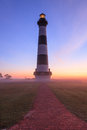 Bodie island lighthouse vertical fog beacon image of the on the cape hatteras national seashore shining its through the on an Stock Photo