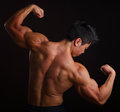 Body Builder Flexing Biceps Royalty Free Stock Photo