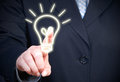 Body of businessperson pressing light bulb on touchscreen ideas and creativity concept Stock Photos