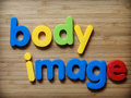 Body image concept in toy letters Stock Photos