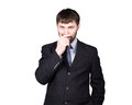 Body language. gestures distrust lies. closes mouth by hand, closed position. man in business suit isolated on white Royalty Free Stock Photo