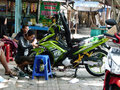 Body lining technicians were the of a motorcycle with a sticker on a market in the city of solo central java indonesia Stock Images