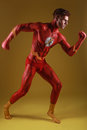 Body painted man as fantasy generic superhero red Royalty Free Stock Photography