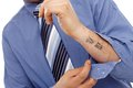 Body part of businessman with tattoo in forearm Royalty Free Stock Photo