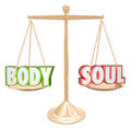 Body and soul words scale balance weighing total health the weighed on a in perfect to illustrate the goal of complete joy Stock Image