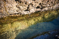 Body of water between gentle colored stones Royalty Free Stock Photo