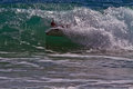 Bodyboarder boogieboarder in the surf photo of a riding curl of a wave Royalty Free Stock Image