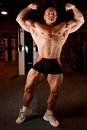 Bodybuilder demonstrates his muscles Royalty Free Stock Image