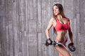 Bodybuilder girl with dumbbell exercising Royalty Free Stock Image
