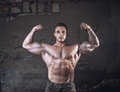 Bodybuilder on grunge wall Royalty Free Stock Photo