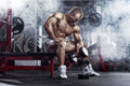 Bodybuilder guy execute exercise with dumbbells Royalty Free Stock Photo