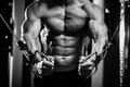 Bodybuilder guy in gym hands close up pumping black and white Stock Photo