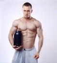 Bodybuilder Holding A Black Pl...