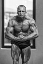 Bodybuilder performing most muscular pose body builder Royalty Free Stock Images