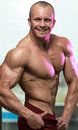 Bodybuilder performing quarter turn right pose body builder Stock Photos