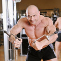 Bodybuilder posing at gym portrait Royalty Free Stock Photo