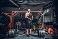 Bodybuilder preparing for deadlift of barbell Royalty Free Stock Photo