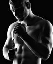 Bodybuilder silhouette of young athlete man on black Stock Photography