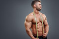 Bodybuilder with tape measure Royalty Free Stock Photo