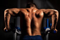 Bodybuilder training in darkness Royalty Free Stock Photo