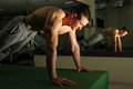 Bodybuilder training hard in the gym doing push ups Royalty Free Stock Images