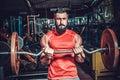 Bodybuilder in training room Royalty Free Stock Photo