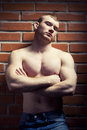 Bodybuilder young athlete man near brick wall Royalty Free Stock Photography