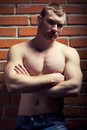 Bodybuilder young athlete man near brick wall Royalty Free Stock Images