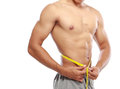 Bodybuilders with perfect abs portrait of men measuring his waist Royalty Free Stock Photos