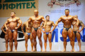 Bodybuilders poses at Open Cup of bodybuilding Royalty Free Stock Photography