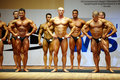 Bodybuilders stand on stage at Championship Stock Images