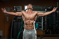 Bodybuilding is not a race it is a marathon portrait of physically fit young man in healthy club Stock Image