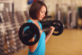 Bodybuilding. woman exercising with barbell in fitness class. Female workout in gym with barbell.. Royalty Free Stock Photo