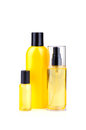Bodycare lotions yellow in bottles on white background Royalty Free Stock Photos