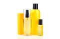 Bodycare treatments lotions in yellow bottles on white background Stock Photos