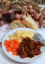 Boeuf bourguignonne meal with wine and bread Royalty Free Stock Photo