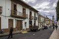 Bogota colombia october typical street of touristy district la candelaria with people walking along the street this photo depicts Royalty Free Stock Images