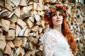 Boho bride with red hair with flowers Royalty Free Stock Photo