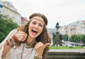 Boho woman tourist on Wenceslas Square, Prague showing thumbs up Royalty Free Stock Photo