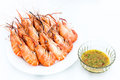 Boil giant river prawn shrim and seafood sauce on white background Royalty Free Stock Photo